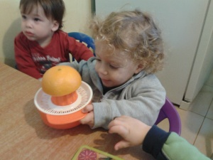 Learning to squeeze oranges - practical life activity